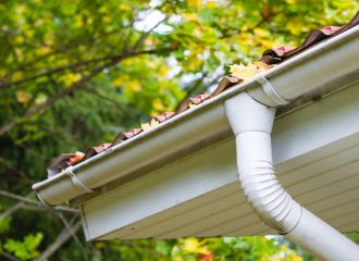 Gutter Cleaning in Montgomery, AL - maple leaves clogging gutter, fall time