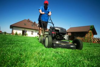 Lawn Care in Montgomery, AL - lawn care specialist pushing lawn mower