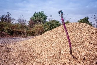 Mulch, Topsoil, Sand, and Gravel Supplier in Montgomery, AL - purple shovel in a big pile of mulch